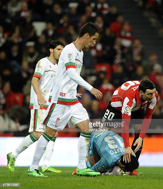 Athletic Bilbao's forward Aritz Aduriz congratulates Granada's goalkeeper Roberto Fernandez after he grabbed a ball during the Spanish league...