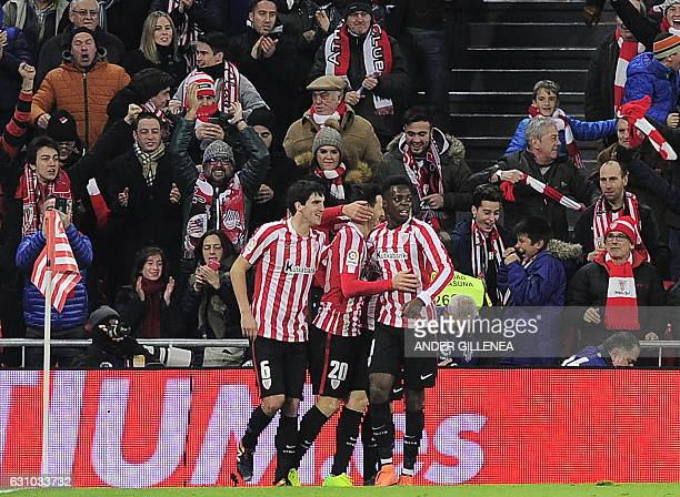 Athletic Bilbao's forward Aritz Aduriz is congratulated by teammates forward Inaki Williams Arthur and midfielder Ander Iturraspe after scoring his...