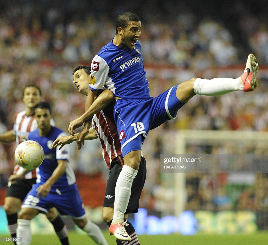 Athletic Bilbao s forward Aritz Aduriz L vies with Hapoel Kiryat