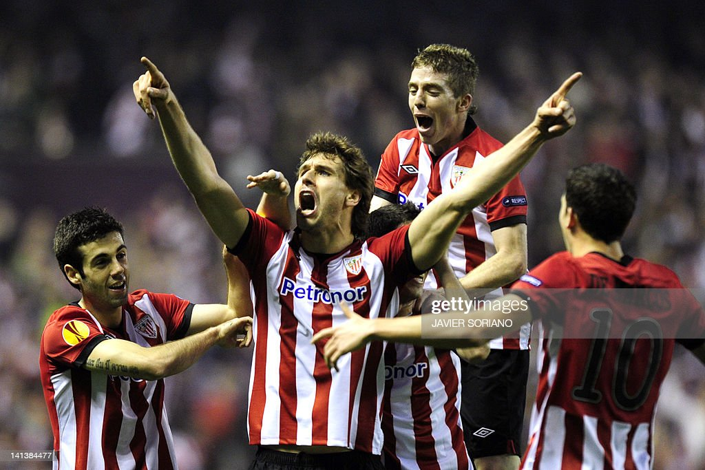 Athletic Bilbao's forward Fernando Llorente (C) celebrates after scoring their first goal during the UEFA Europa round of 16 second leg football match Athletic Bilbao against Manchester United on March 15, 2012 at San Mames stadium in Bilbao.