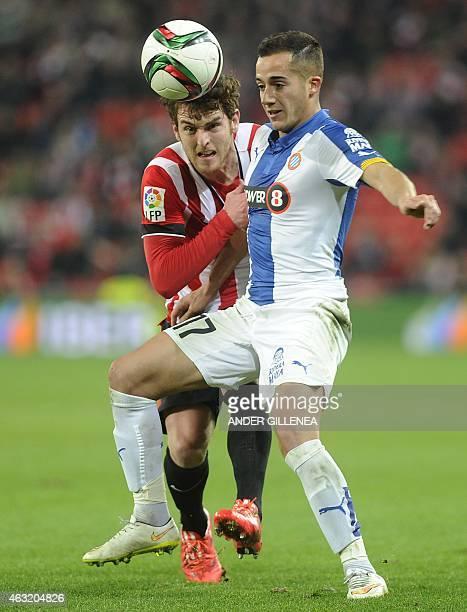 Athletic Bilbao's forward Ibai Gomez vies with Espanyol's forward Lucas Vazquez during the Spanish Copa del Rey semifinal first leg football match...