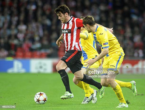 Athletic Bilbao's forward Ibai Gomez vies with midfielder Edgar Olekhnovich during the UEFA Champions League Group H football match Athletic Club...