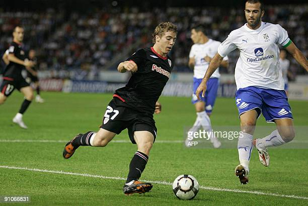 Athletic Bilbao's forward Iker Muniain vies for the ball with Tenerife's defender Manolo Martinez during their Spanish league football match on...
