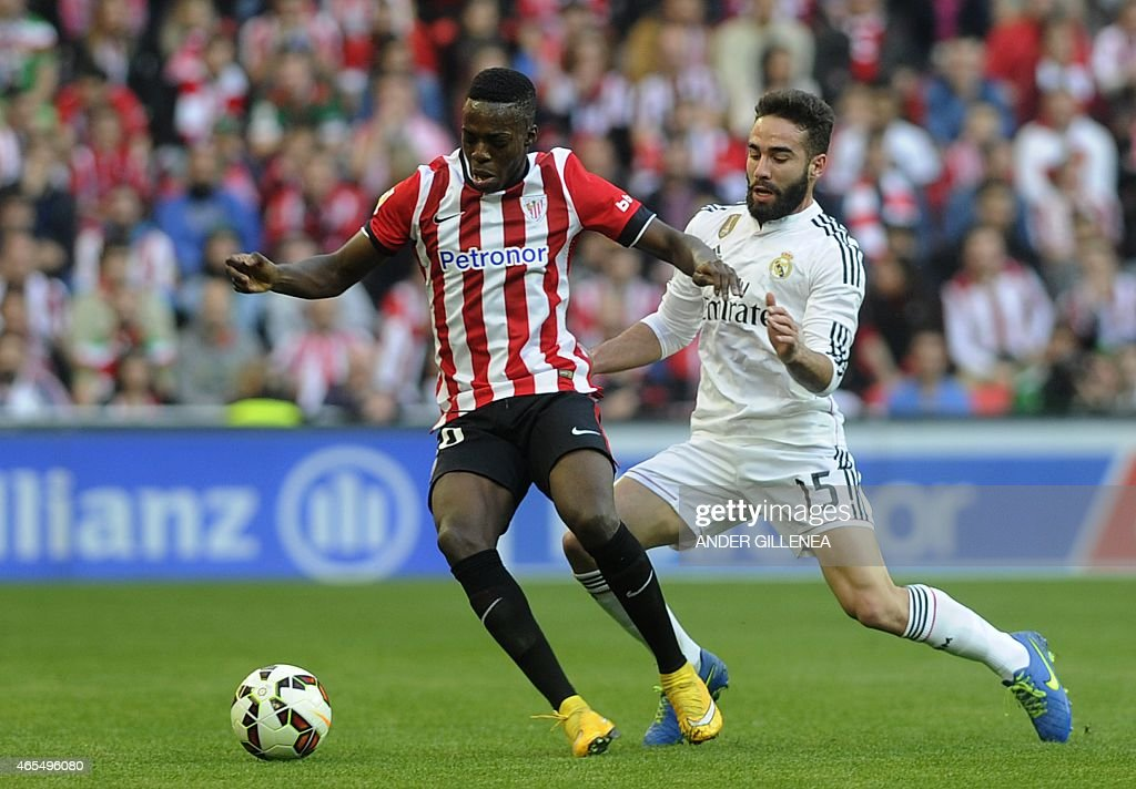 Athletic Bilbao's forward Inaki Williams (L) vies with Real Madrid's defender Daniel Carvajal during the Spanish league football match Athletic Club Bilbao vs Real Madrid CF at the San Mames stadium in Bilbao on March 7, 2015.