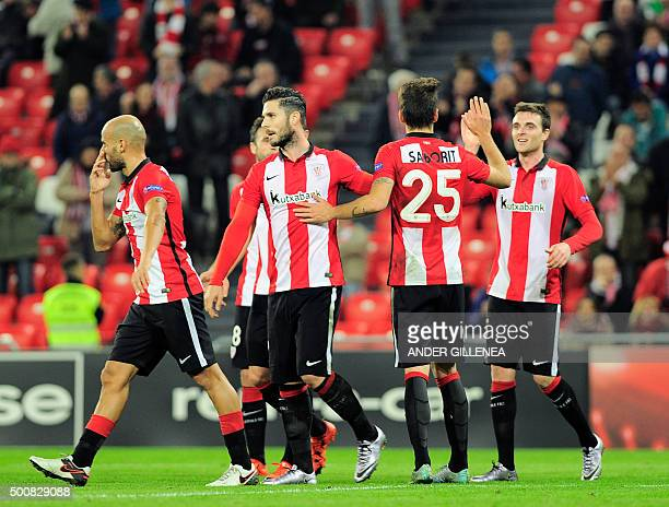 Athletic Bilbao's forward Kike Sola is congratulated by teammates after scoring during the UEFA Europa League football match Athletic Club Bilbao vs...