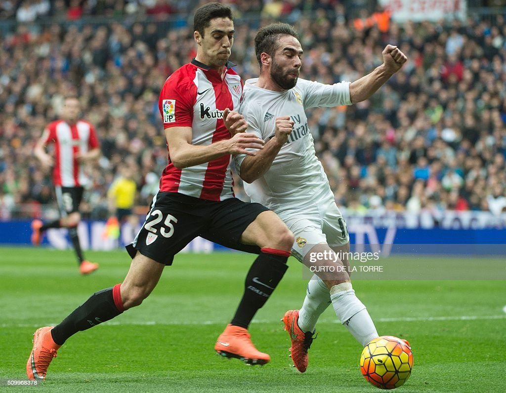 Athletic Bilbao's forward Sabin (L) vies with Real Madrid's defender Dani Carvajal during the Spanish league football match Real Madrid CF vs Athletic Club Bilbao at the Santiago Bernabeu stadium in Madrid on February 13, 2016. / AFP / CURTO DE LA TORRE