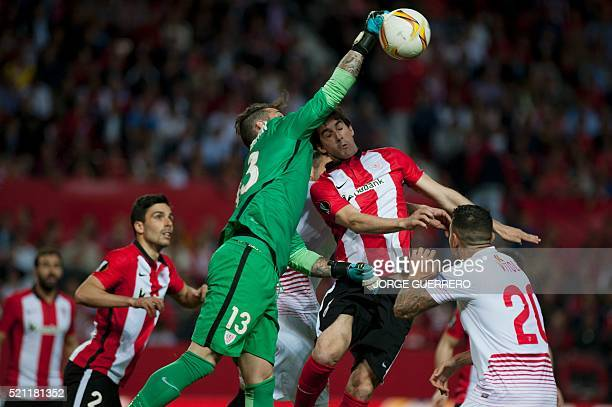 Athletic Bilbao's goalkeeper Iago Herrerin and defender Mikel San Jose vie with Sevilla's midfielder Vitolo during the UEFA Europa League quarter...