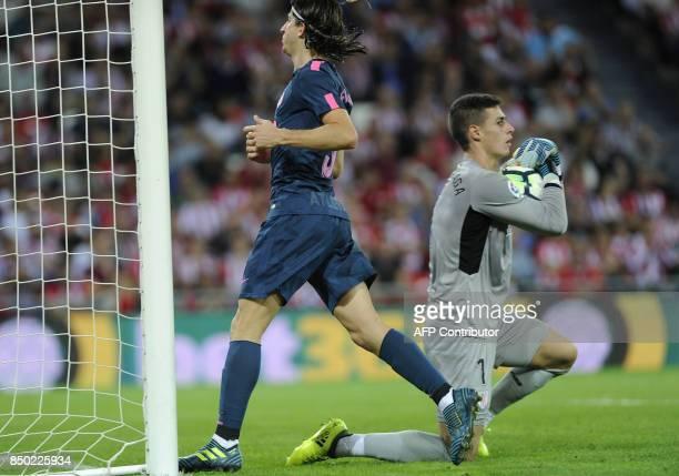 Athletic Bilbao's goalkeeper Kepa Arrizabalaga vies with Atletico Madrid's Brazilian defender Filipe Luis during the Spanish league football match...