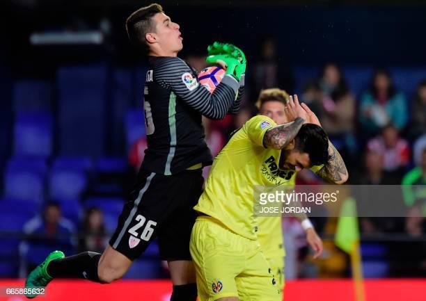 Athletic Bilbao's goalkeeper Kepa Arrizabalga vies with Villarreal's Italian midfielder Roberto Soriano during the Spanish league football match...