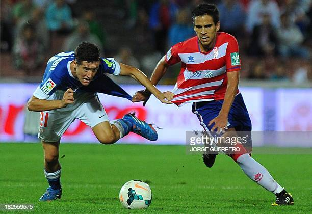 Athletic Bilbao's midfielder Ander Herrera vies with Granada's midfielder Recio during the Spanish league football match Granada FC vs Athletic...