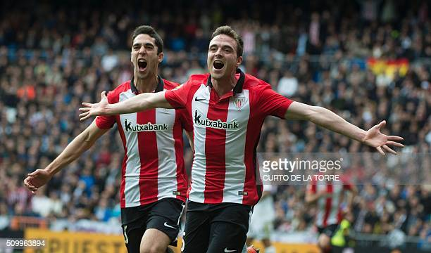 Athletic Bilbao's midfielder Javier Eraso Goni celebrates after scoring during the Spanish league football match Real Madrid CF vs Athletic Club...
