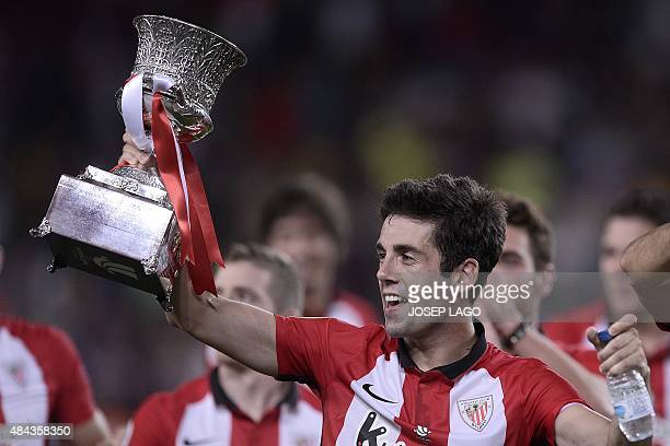 Athletic Bilbao's midfielder Markel Susaeta holds the Spanish Supercup trophy after the Spanish Supercup match FC Barcelona vs Athletic club Bilbao...