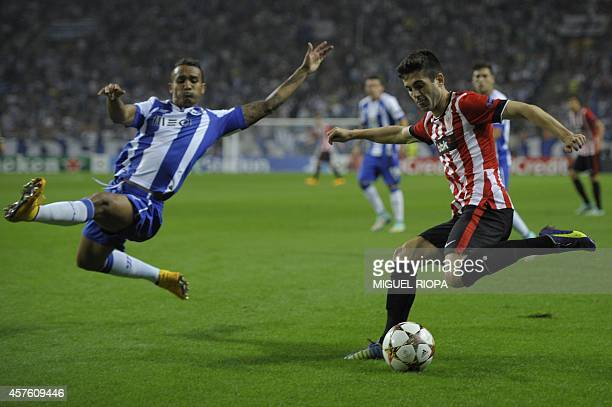 Athletic Bilbao's midfielder Markel Susaeta vies with Porto's Brazilian defender Danilo during the UEFA Champions League football match FC Porto vs...