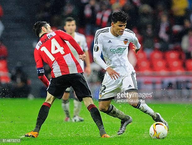 Athletic Bilbao's midfielder Markel Susaeta vies with Valencia's Salvadoran midfielder Danilo Barbosa during the UEFA Europa League Round of 16 first...