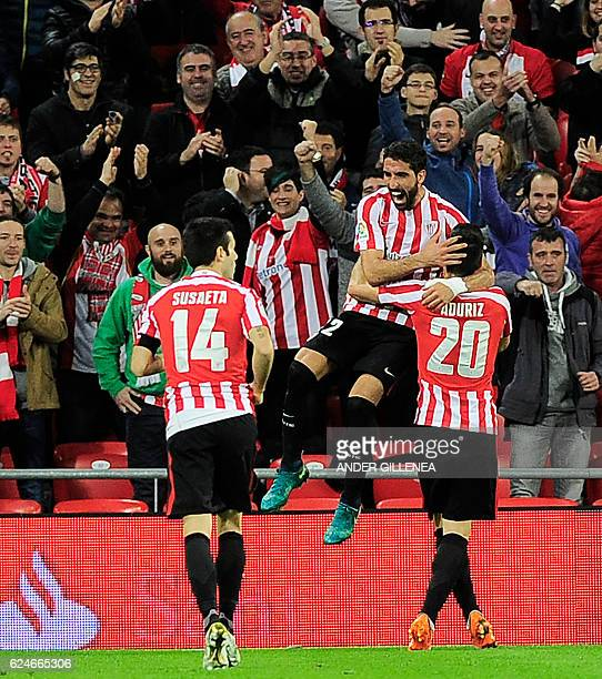 Athletic Bilbao's midfielder Raul Garcia celebrates with midfielder Markel Susaeta and forward Aritz Aduriz after scoring their team's first goal...