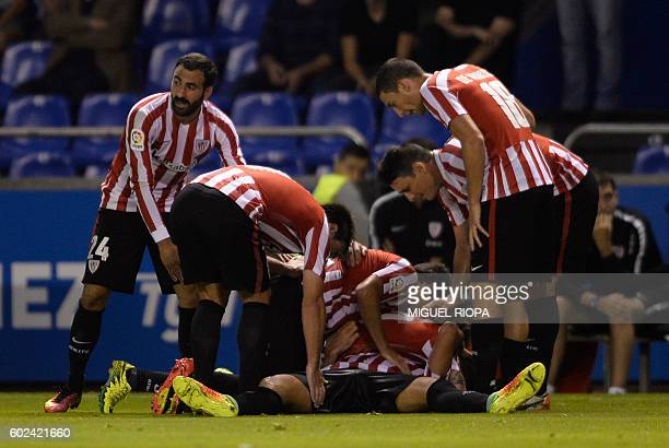 Athletic Bilbao's midfielder Raul Garcia is congratulated by teammates after scoring a goal during the Spanish league football match RC Deportivo vs...