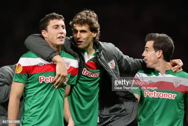Athletic Bilbao's Oscar De Marcos Fernando Llorente and Soto Inigo Perez celebrate victory after the final whistle