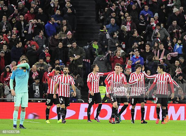 Athletic Bilbao's players celebrate after Athletic Bilbao's forward Aritz Aduriz scored his team's first goal during the Spanish Copa del Rey round...