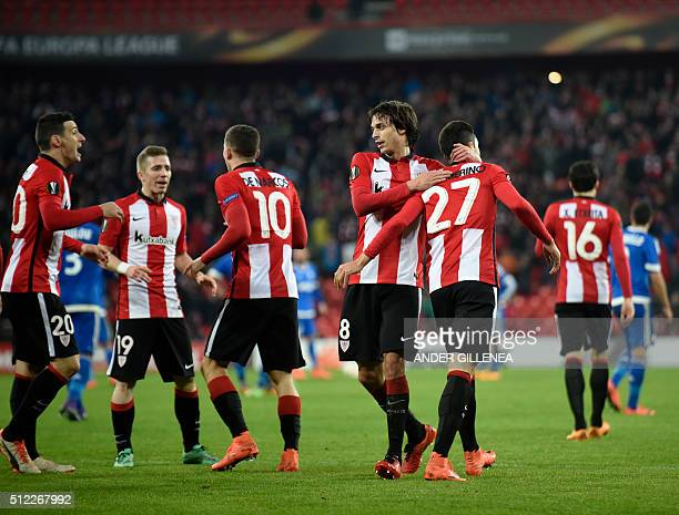 Athletic Bilbao's players celebrate after Sabin Merino scored during the UEFA Europa League Round of 32 second leg football match Athletic Club...