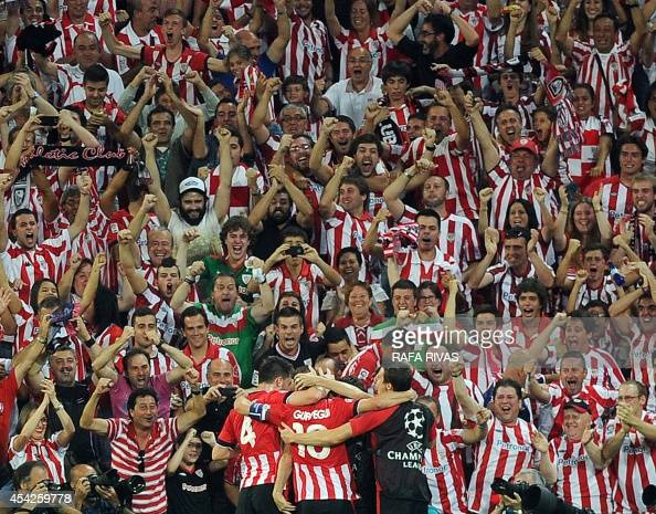 Athletic Bilbao's players celebrate after scoring during the UEFA Champions League playoff second leg football match Athletic Bilbao vs SSC Napoli at...