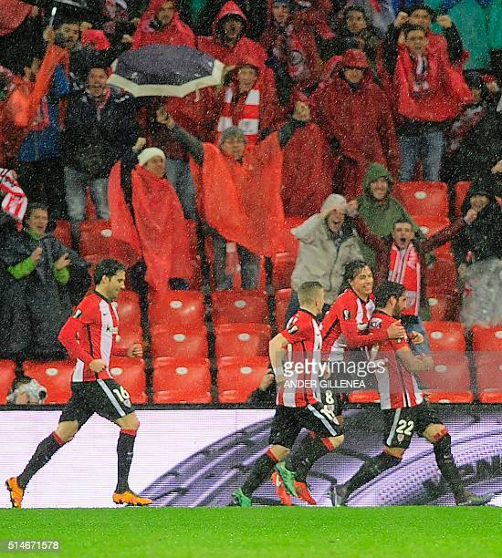 Athletic Bilbao's players celebrate after scoring during the UEFA Europa League Round of 16 first leg football match Athletic Club Bilbao vs Valencia...