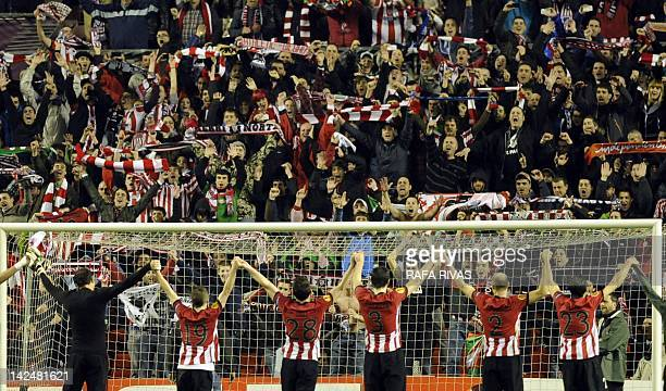 Athletic Bilbao's players celebrate with their supporter at the end of the UEFA Europe League quarterfinal second leg football match Athletic Bilbao...