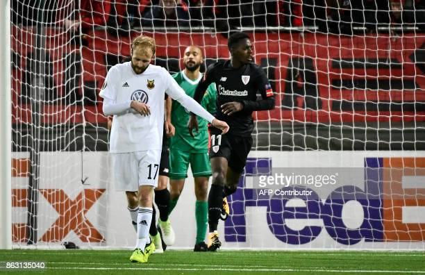 Athletic Bilbao's Spanish forward Inaki Williams celebrates scoring the 22 goal next to Ostersunds' midfielder from England Curtis Edwards and...