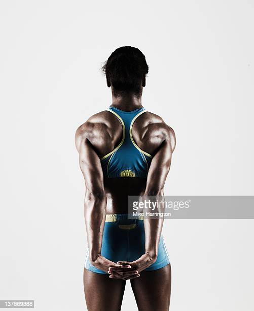 Athletic Black Female Showing Muscular Back