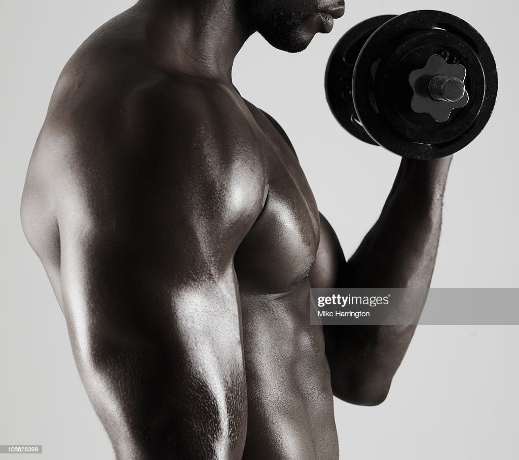Athletic Black Male Lifting Weight : Stock Photo
