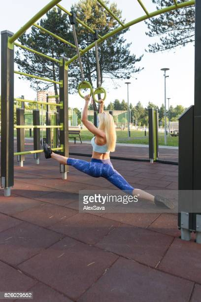 Athletic blonde woman stretching before her fitness training routine outdoor