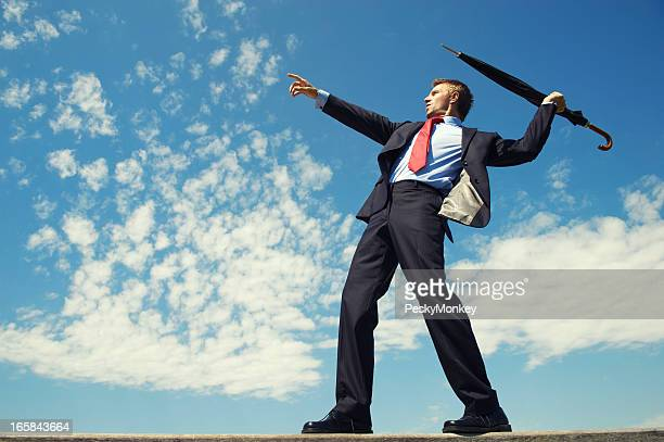 Athletic Businessman Throwing Javelin Umbrella Blue Sky Outdoors