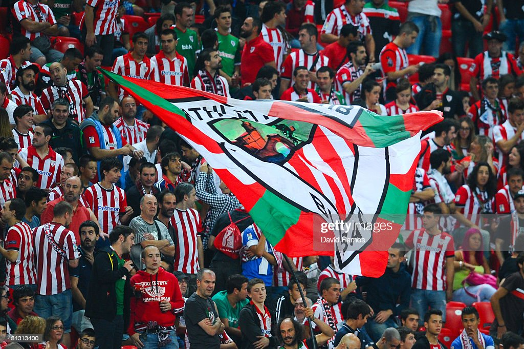 Athletic Club supporters cheer on their team during the Spanish Super Cup first leg match between FC Barcelona and Athletic Club at San Mames Stadium...