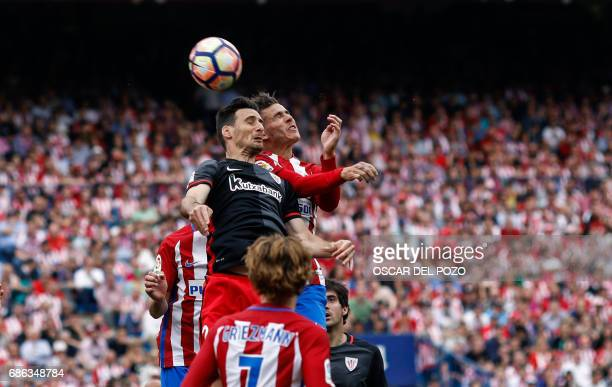 Athletic de Bilbao's forward Aduriz vies with Atletico de Madrid's defender Lucas during the Spanish league football match Club Atletico de Madrid vs...