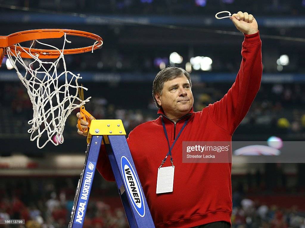 Athletic director Tom Jurich of the Louisville Cardinals cuts down a piece of the net as he celebrates their 82-76 win against the Michigan Wolverines during the 2013 NCAA Men's Final Four Championship at the Georgia Dome on April 8, 2013 in Atlanta, Georgia.