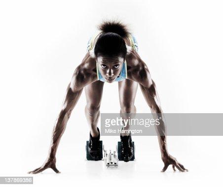 Athletic Female Sprinter On Starting Blocks