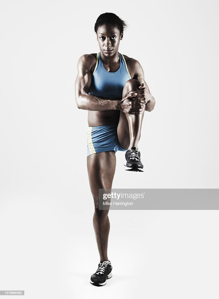 Athletic Female Stretching Leg : Stock Photo