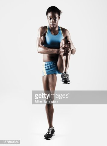 Athletic Female Stretching Leg : Foto de stock