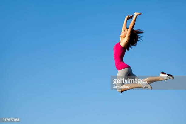 Athletic Girl Jumps High in the Sky