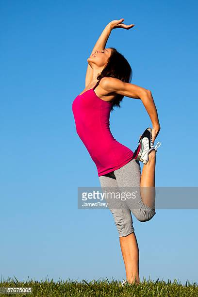 Athletic Girl Stretches Prior to Running on Hilltop