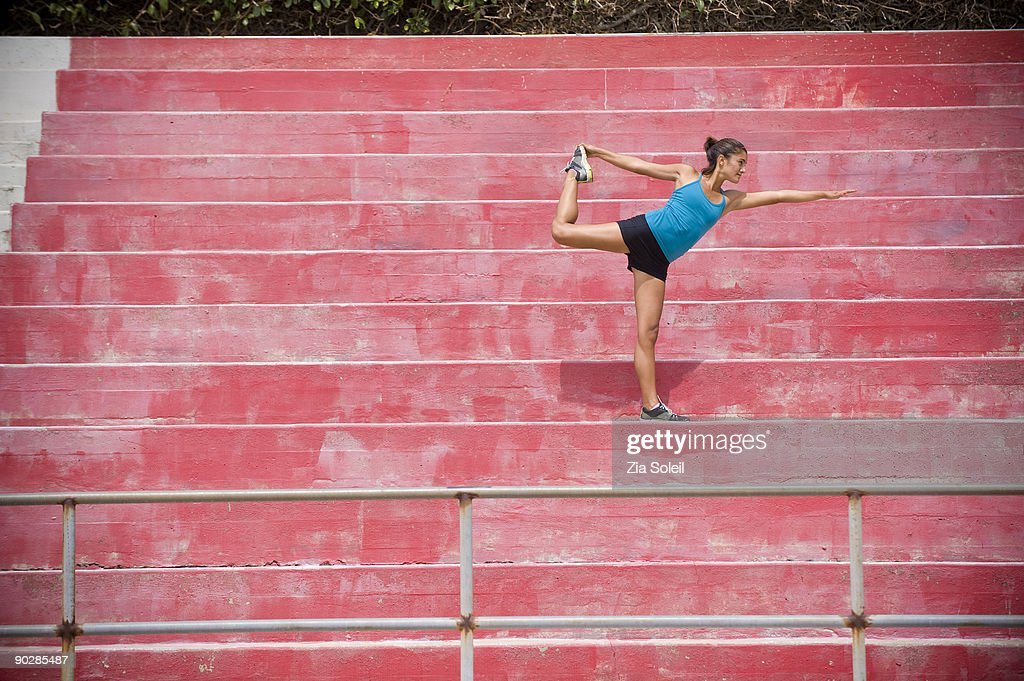 athletic girl stretching at stadium : Stock Photo