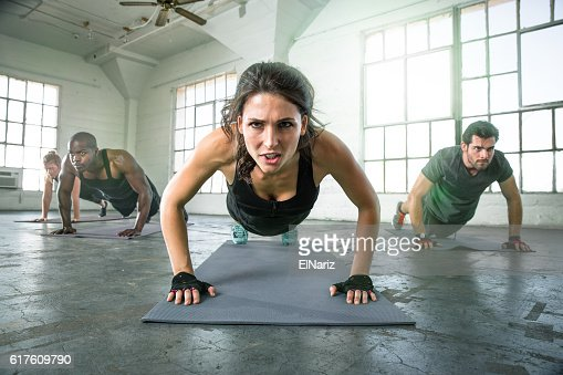 Athletic group fit multi ethnic people exercising vigor vitality passion : Stock-Foto