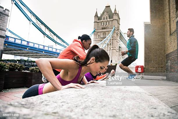 Athletic group people exercising in London