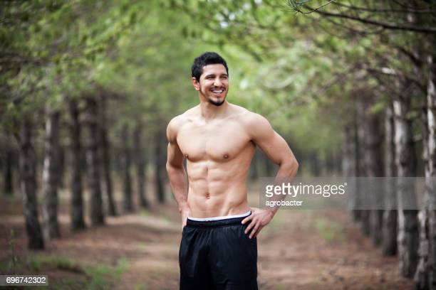 Athletic man in forest