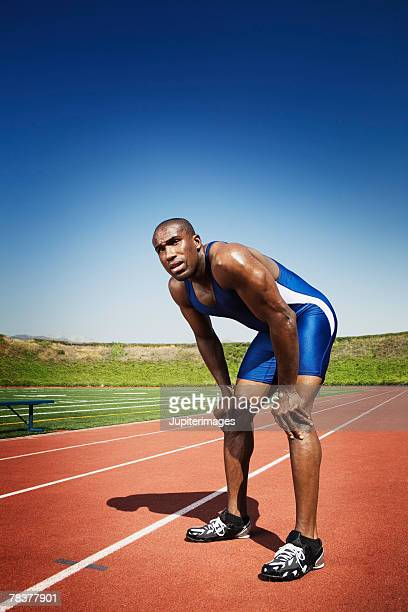 Athletic man resting after losing race