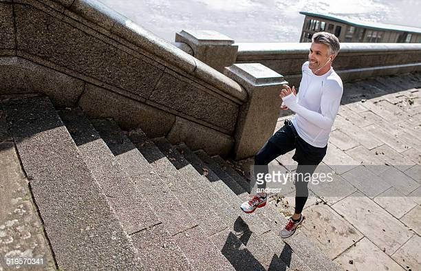 Athletic man running outdoors