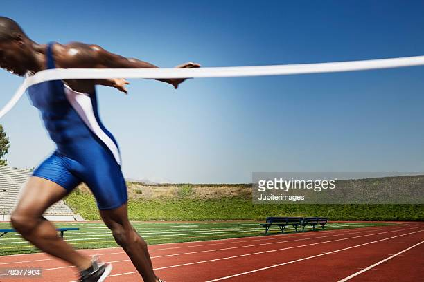 Athletic man winning race