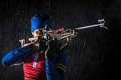 Athletic man with biathlon rifle