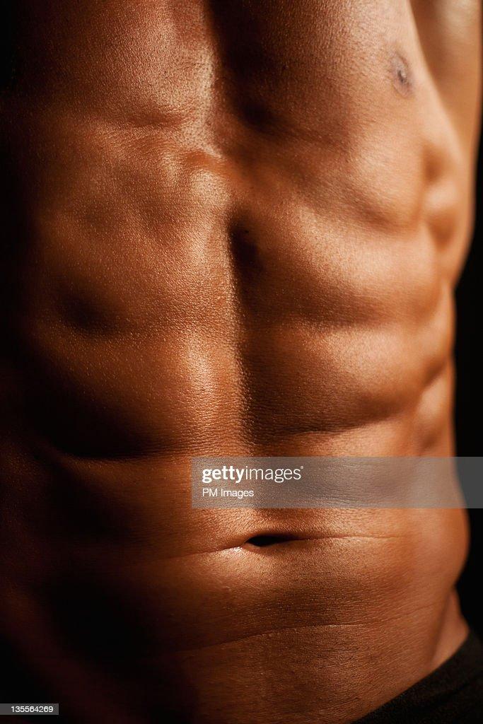 Athletic man's abdomen : Stock Photo