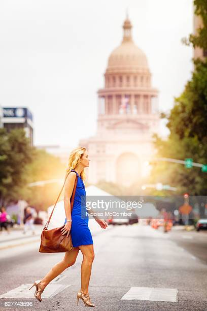 Athletic mature woman crossing Austin Congress street