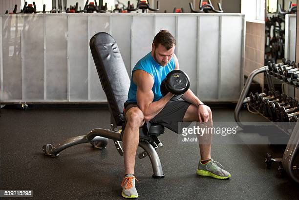 Athletic Mid Adult Man Doing a Weightlifting Workout.